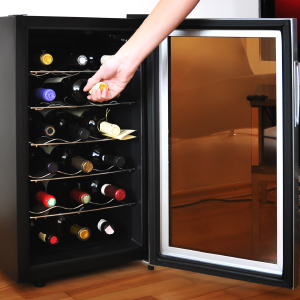 Someone pulling out wine from the refrigerator
